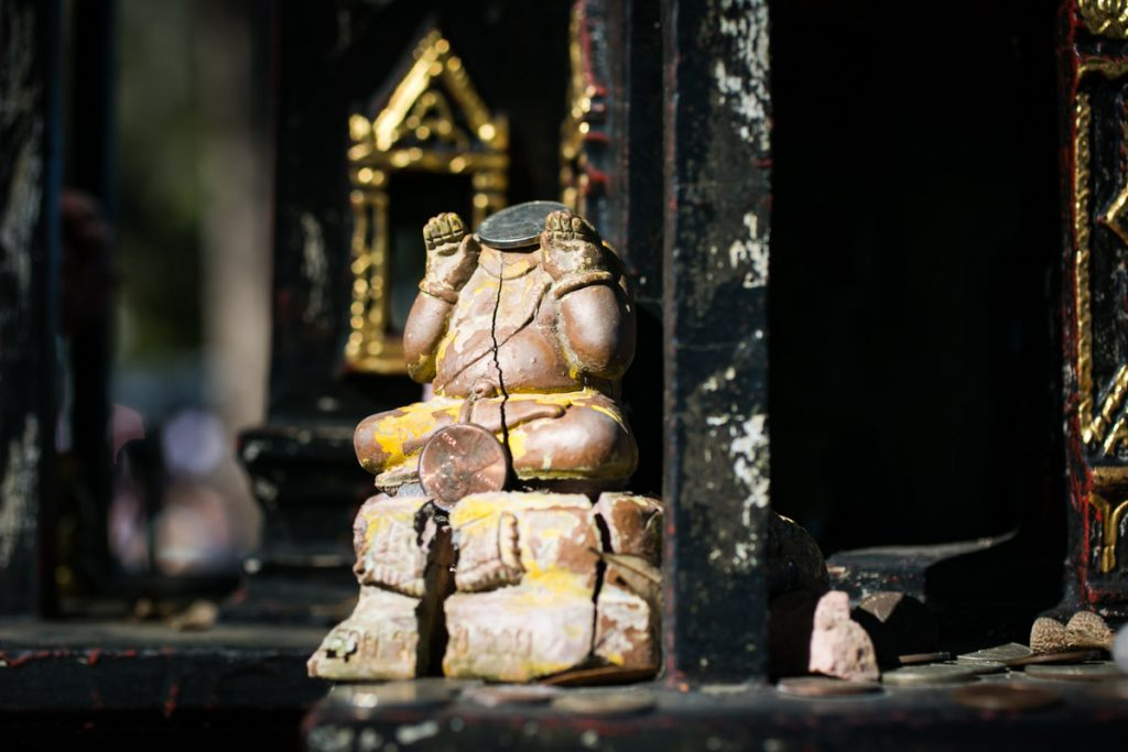 An outside altar at the Wat Mongkolratanaram, photographed by NYC photojournalist, Kelly Williams