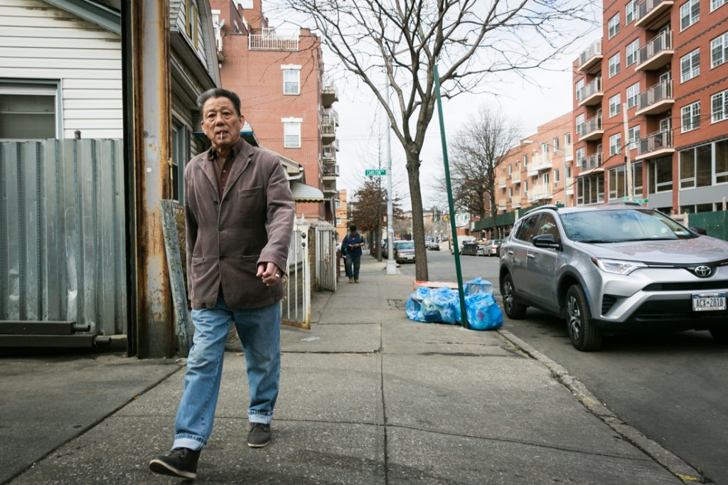 Man with cigarette walking in Flushing Queens street photography series