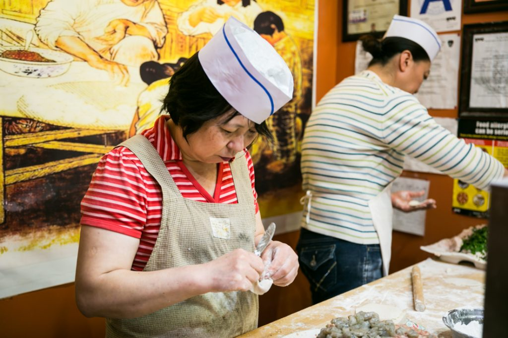 Women making dumplings in the Flushing J Mart in Flushing Queens street photography series