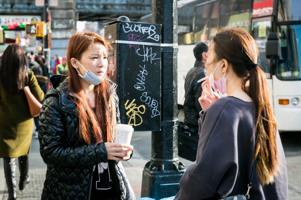 Two women talking on the streets in Flushing Queens street photography series