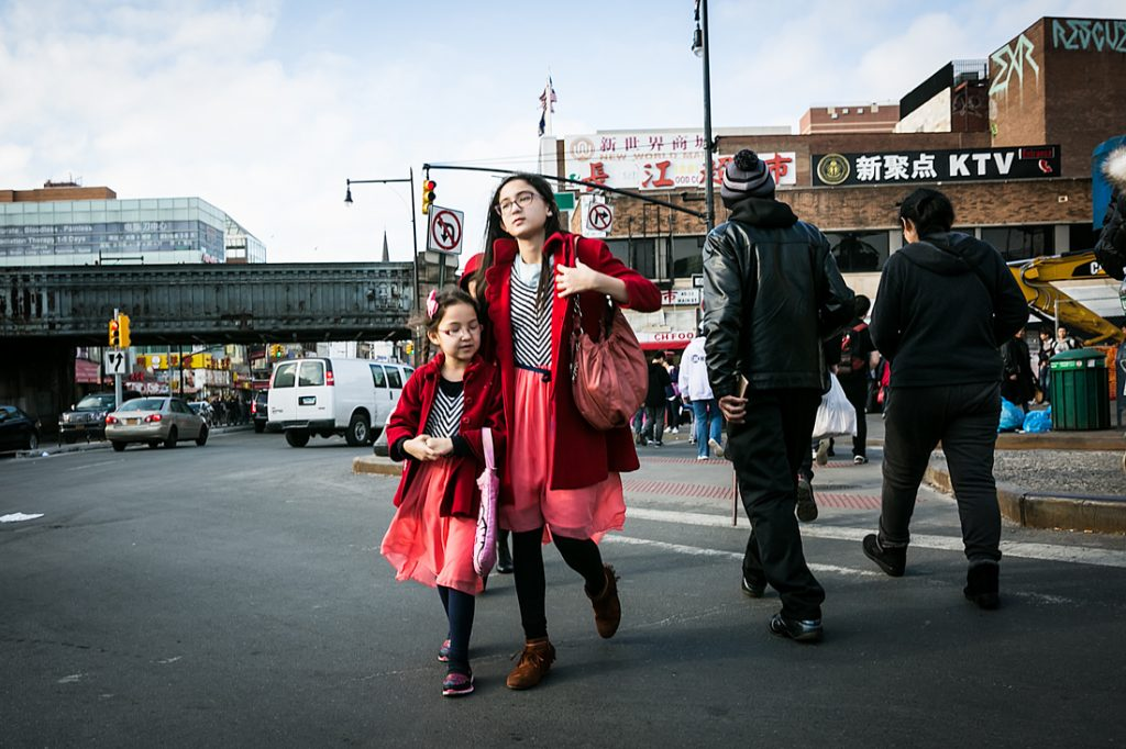 Two sisters walking in Flushing Queens street photography series