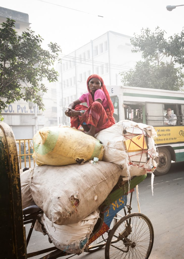 Woman sitting on a cart in India