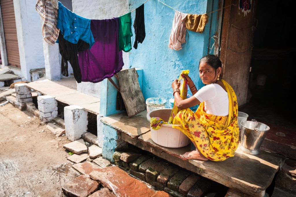 Woman washing clothes on the street in Agra, India
