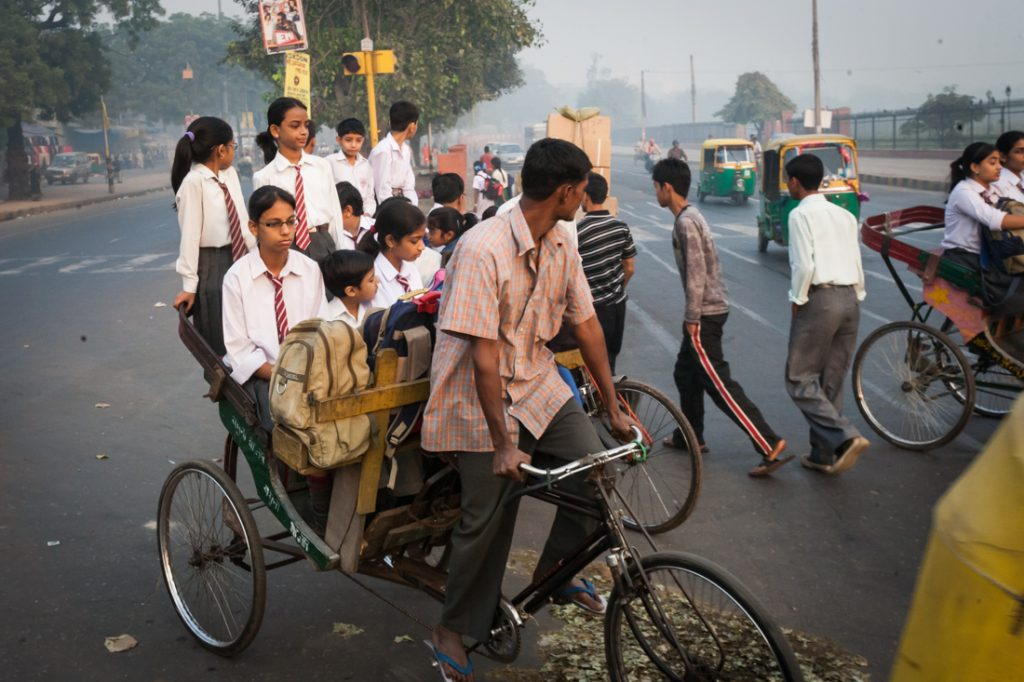 Children being driven to school in Delhi, India