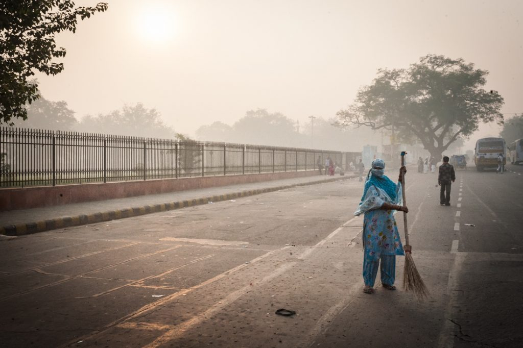 Street sweeper in Delhi, India