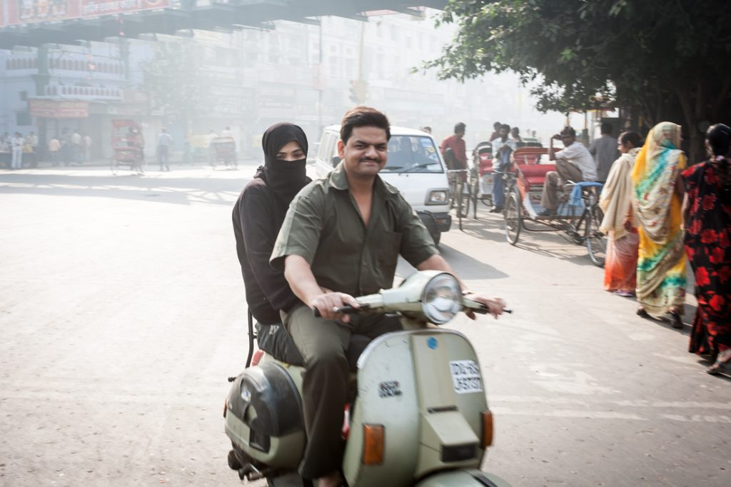 Couple on a scooter in Delhi, India