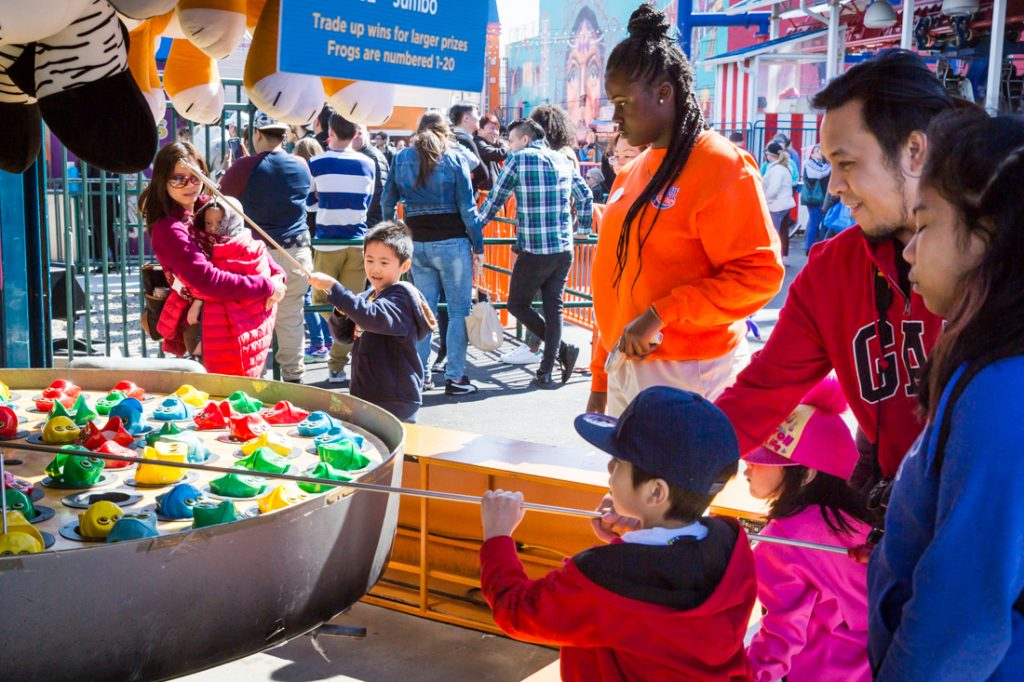 Kids playing amusement games on Coney Island opening day 2017