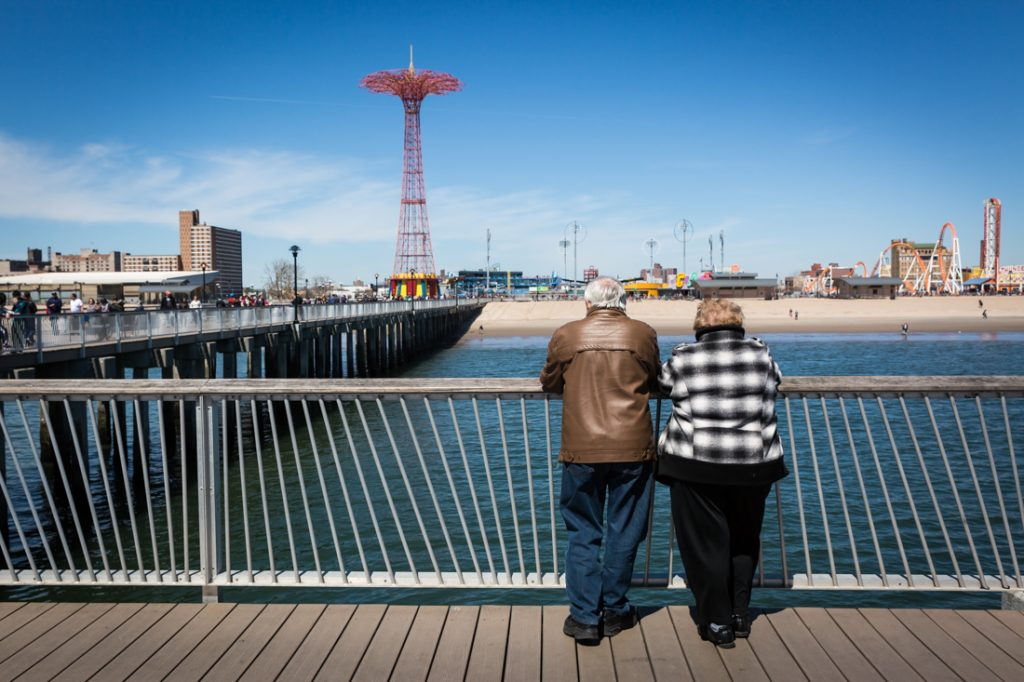 People on the boardwalk on Coney Island opening day 2017