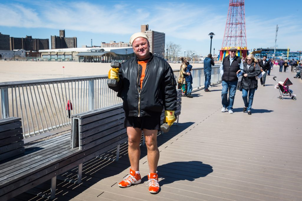 Strong man on the boardwalk on Coney Island opening day 2017