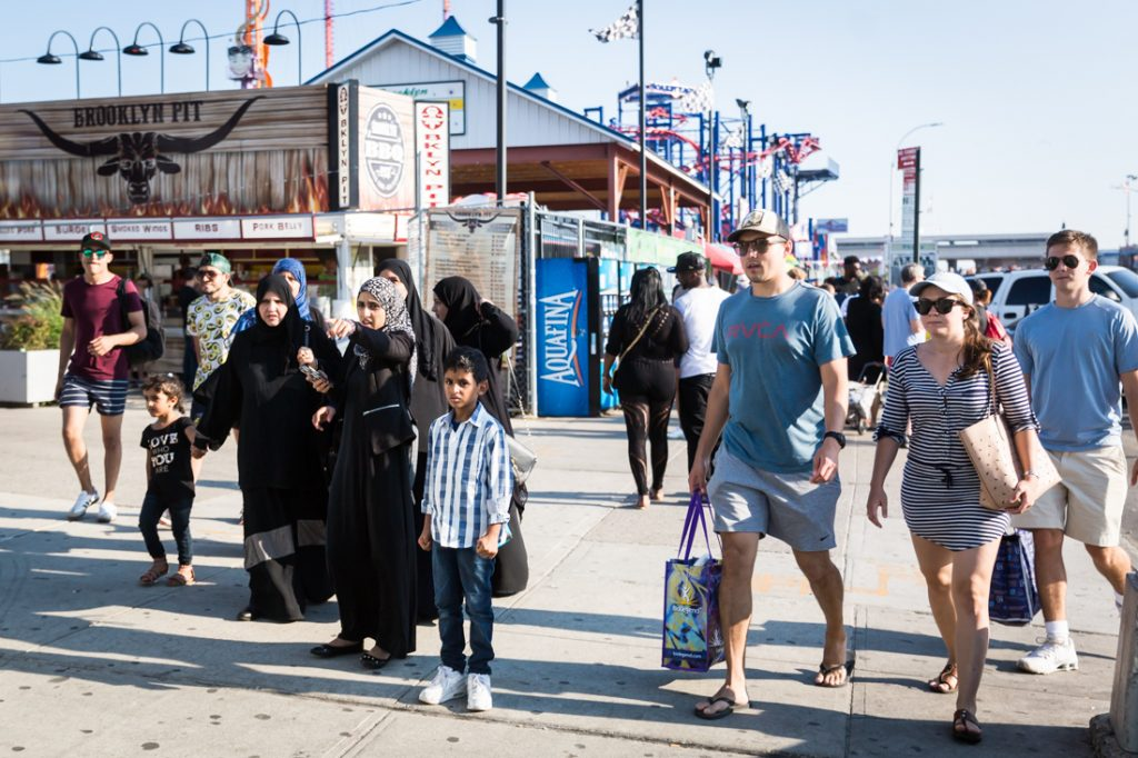 Coney Island street photography of people on the boardwalk