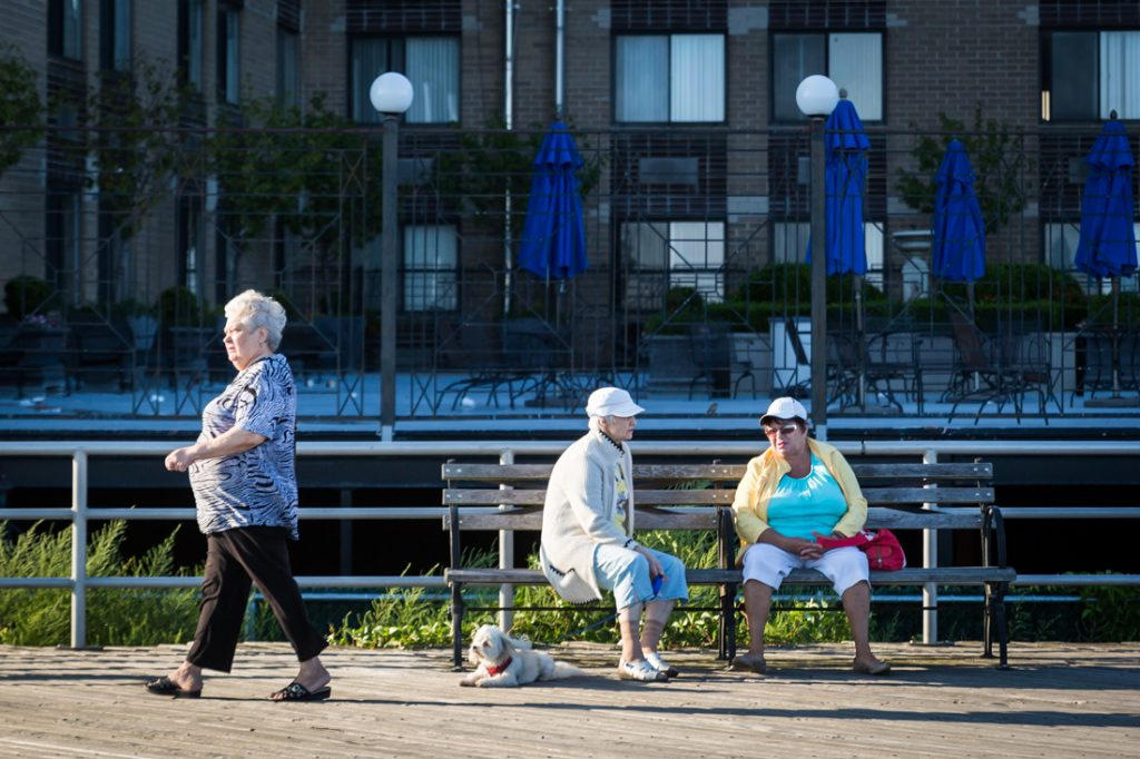 Coney Island street photography of three older women on the boardwalk