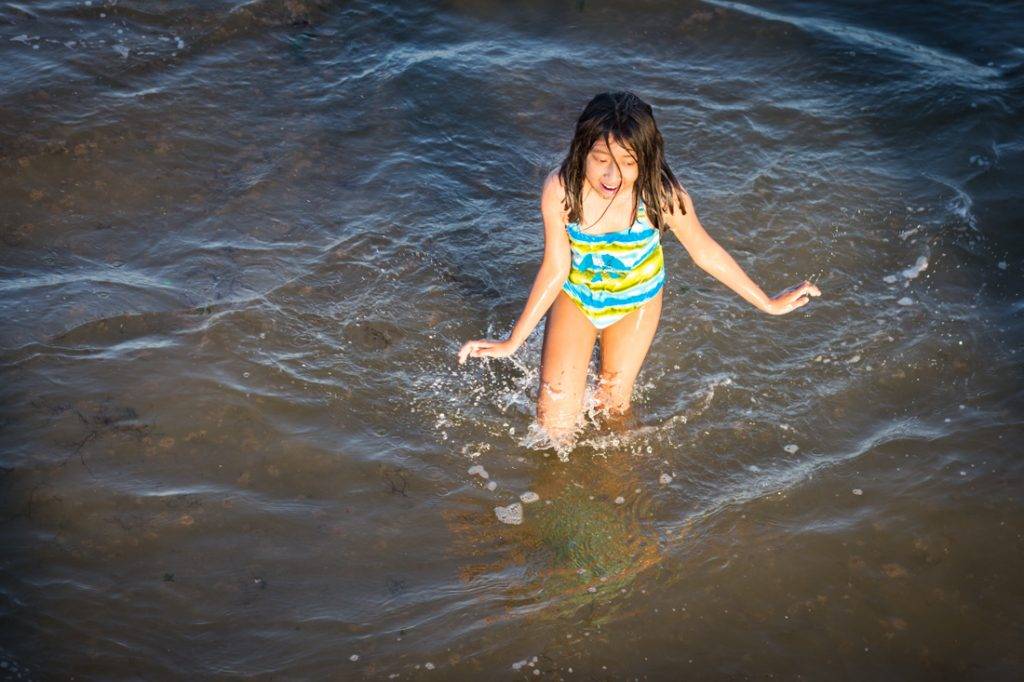 Coney Island street photography of a girl in the ocean