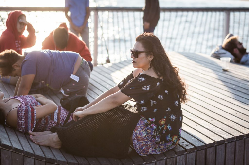 Coney Island street photography of a woman in sunglasses on the pier