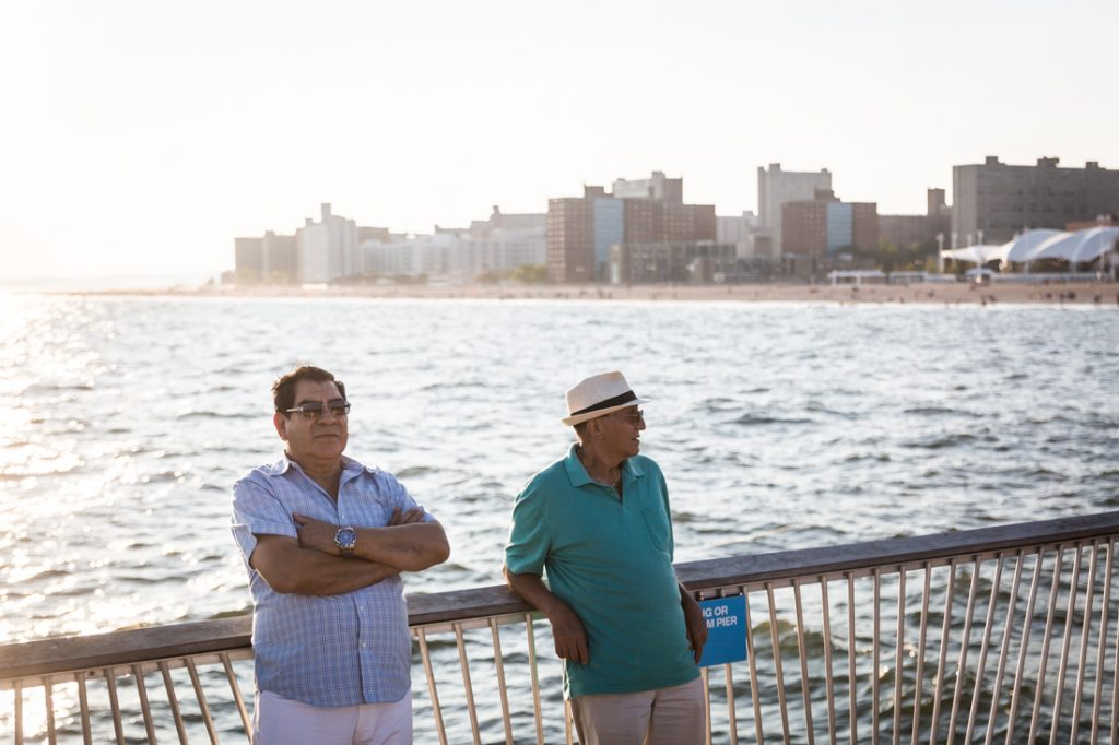 Coney Island street photography of two men on the pier
