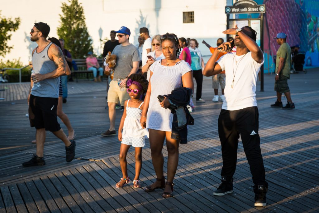 Coney Island street photography of a mother and child wearing sunglasses
