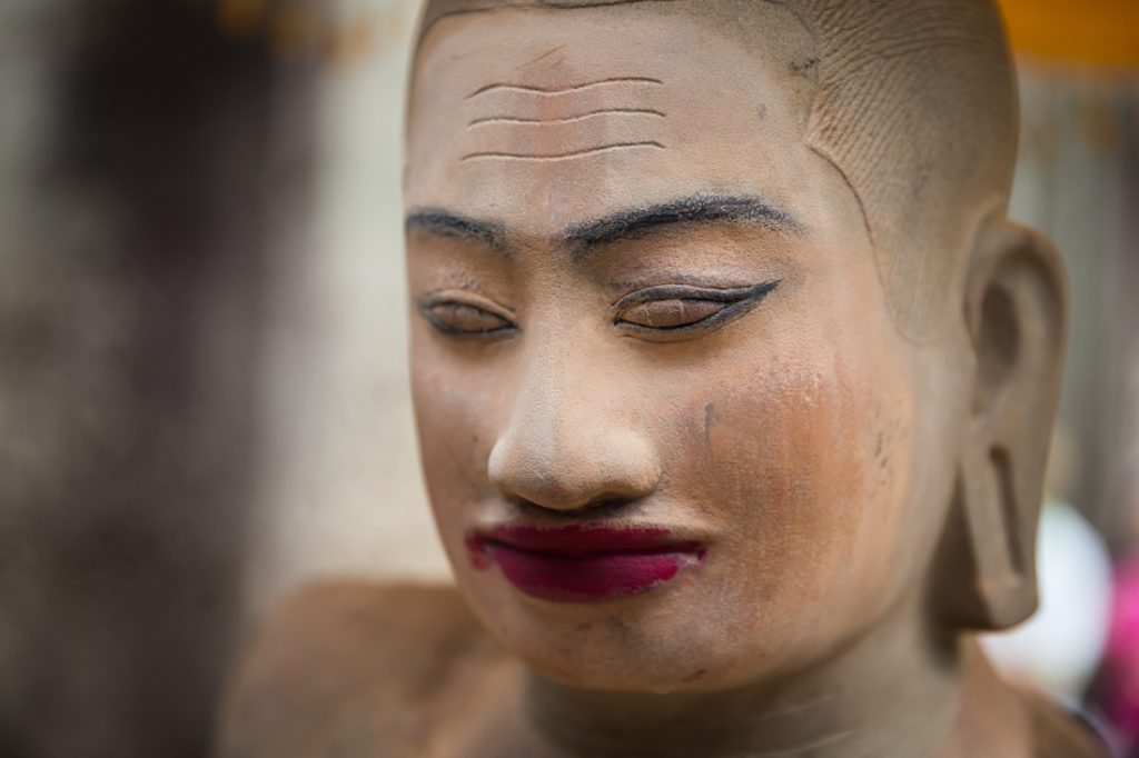 Sculpture with makeup for an Angkor Wat temple guide