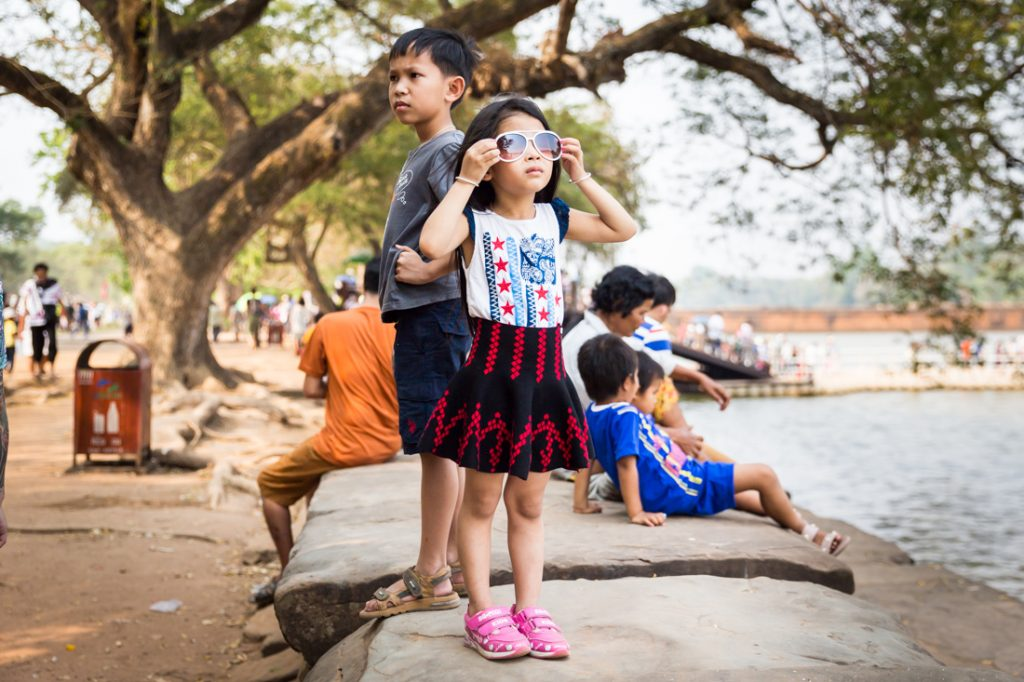Little girl wearing sunglasses for an article on Angkor Wat travel tips