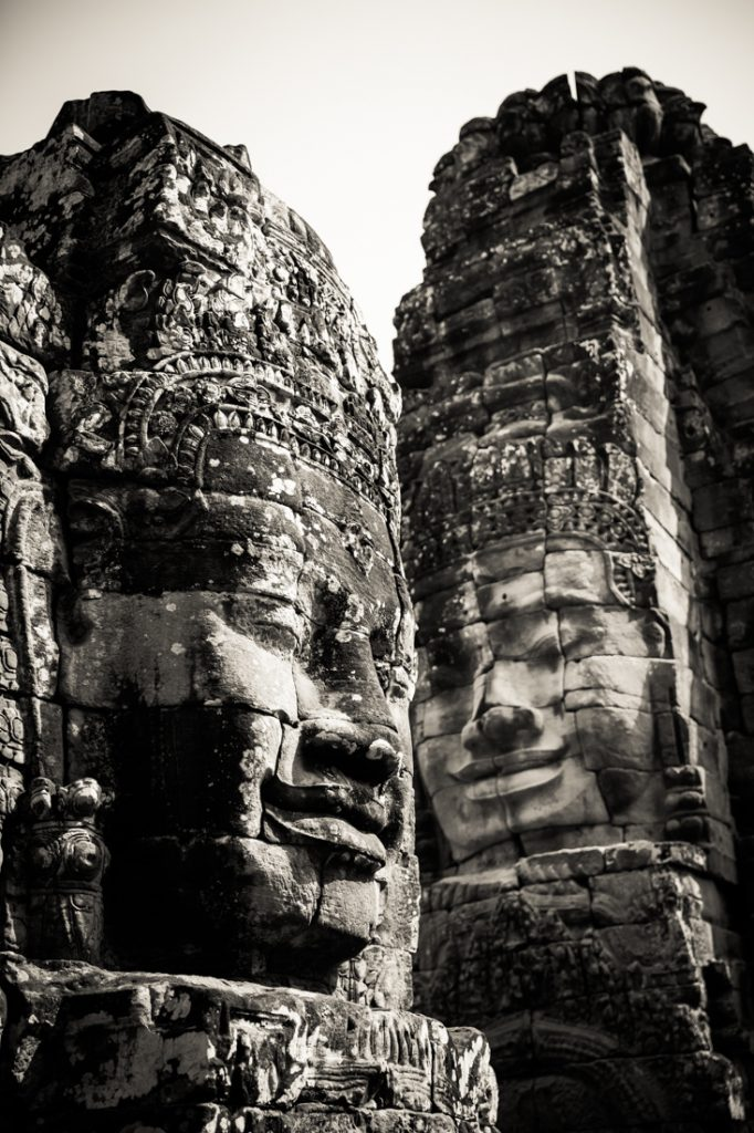 Face statues at Bayon Temple for an article on Angkor Wat travel tips