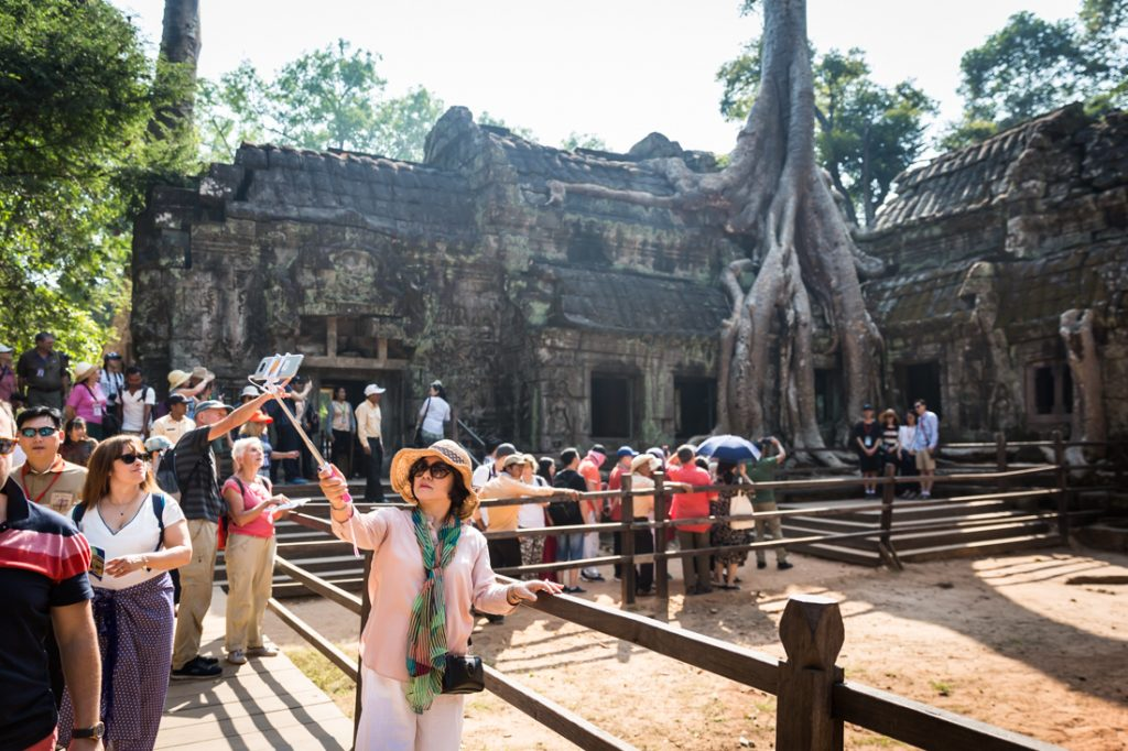 Tourists at Ta Prohm Temple for an article on Angkor Wat travel tips
