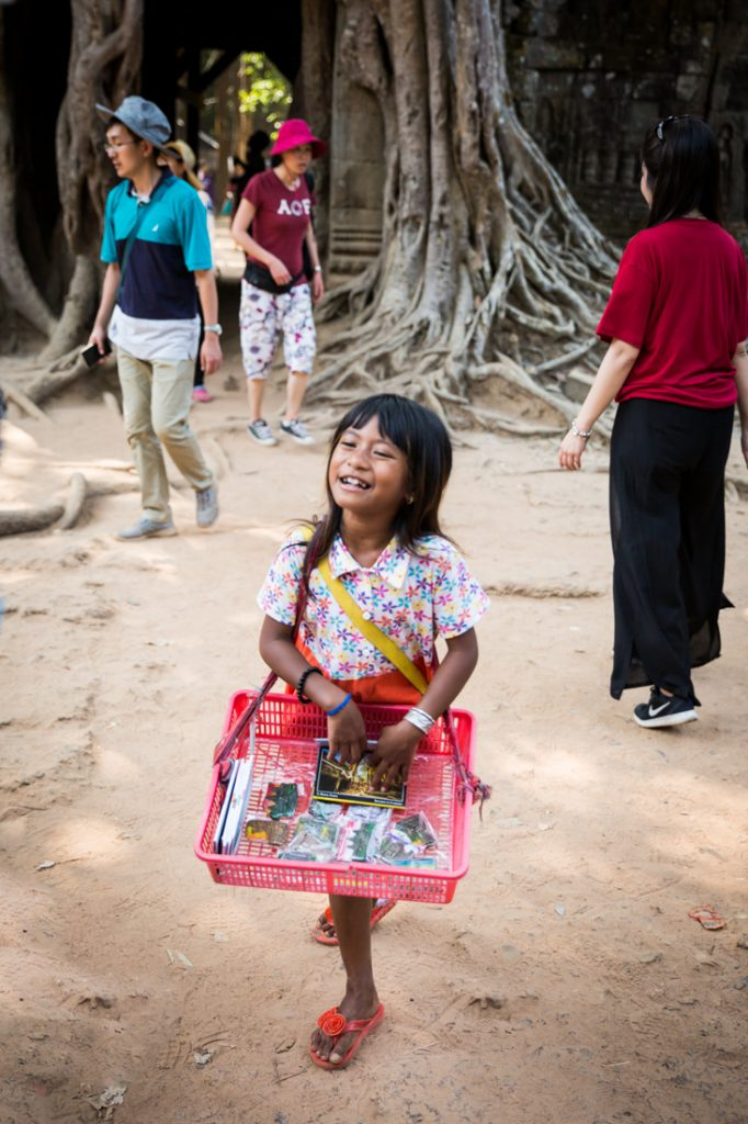 Little girl selling things for an article on Angkor Wat travel tips