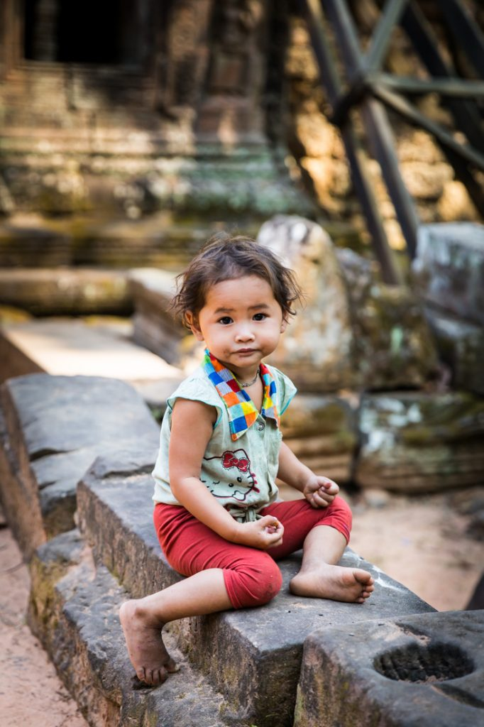 Little girl sitting for an article on Angkor Wat travel tips