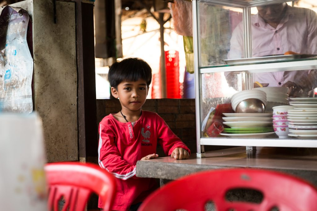 Kid with red shirt for an article on Siem Reap travel tips