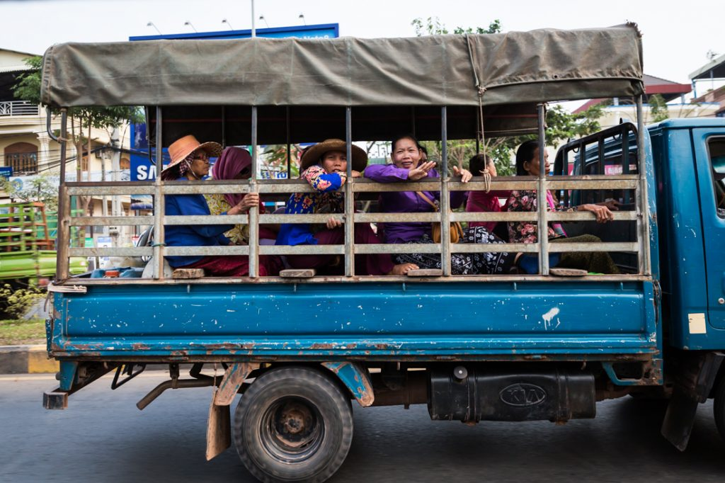 Women traveling by truck for an article on Siem Reap travel tips