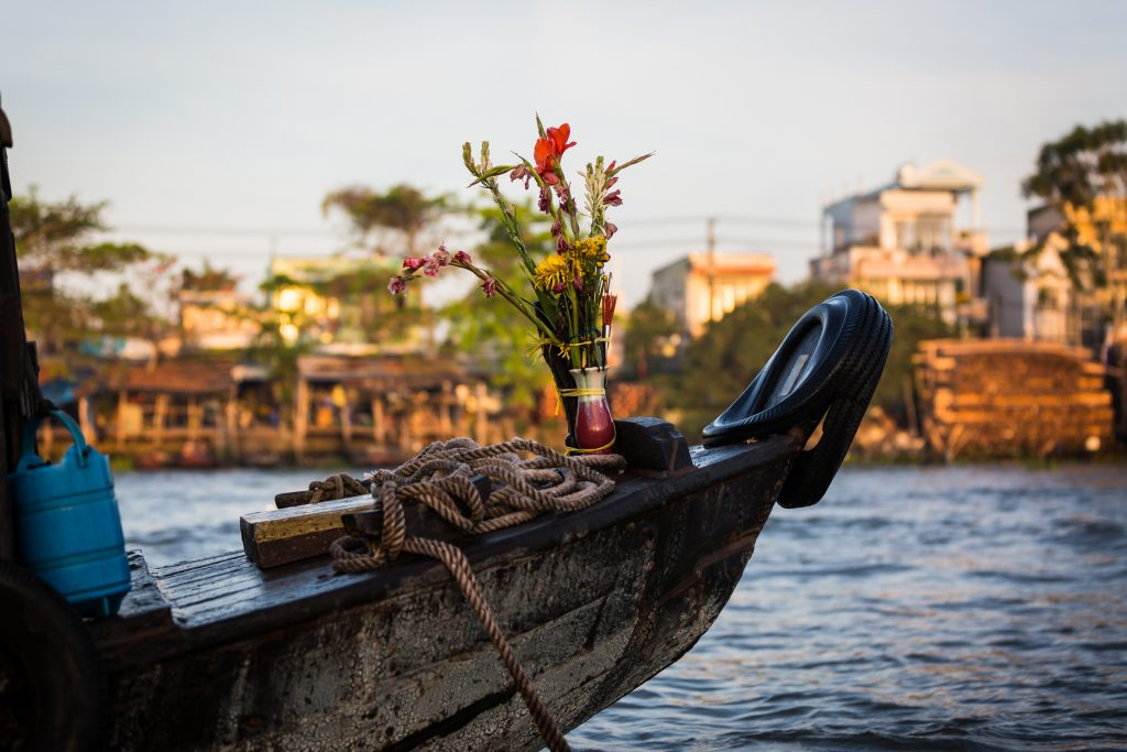 Flowers decorating a boat at the Cai Rang Floating Markets