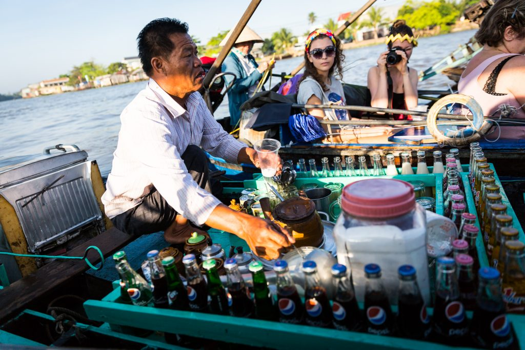 Tourists and coffee seller at the Cai Rang Floating Markets