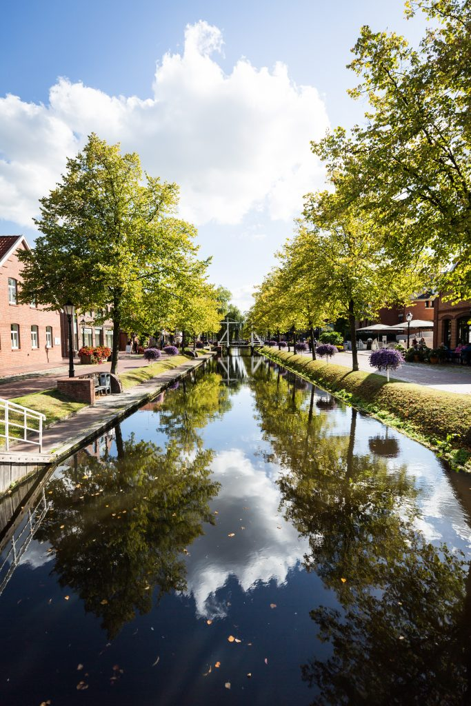 Canal with reflection of trees in Papenburg, Germany