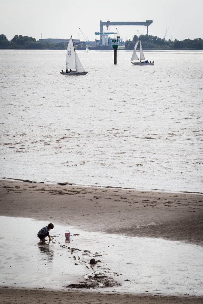 Kid on shore in Blankenese, Germany