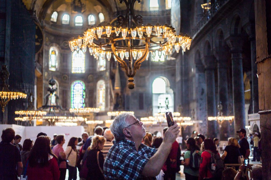Tourist taking photos in Hagia Sophia for an article on Istanbul street photos