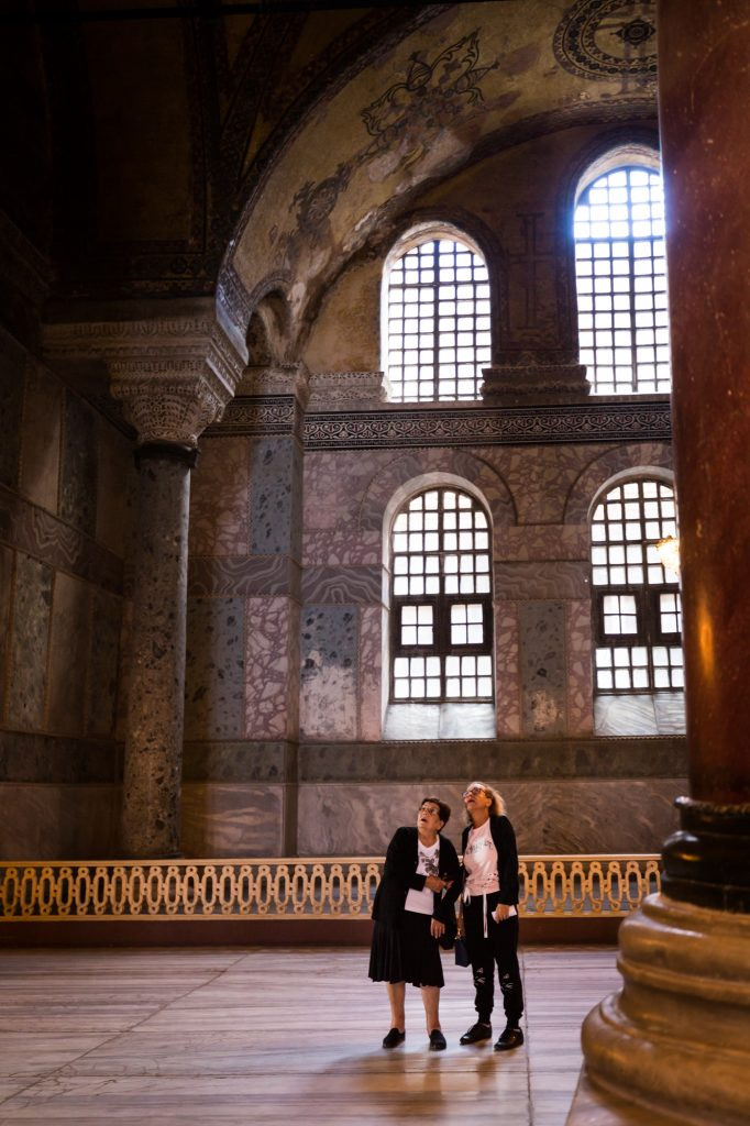Two women tourists at Hagia Sophia for an article on Istanbul street photos