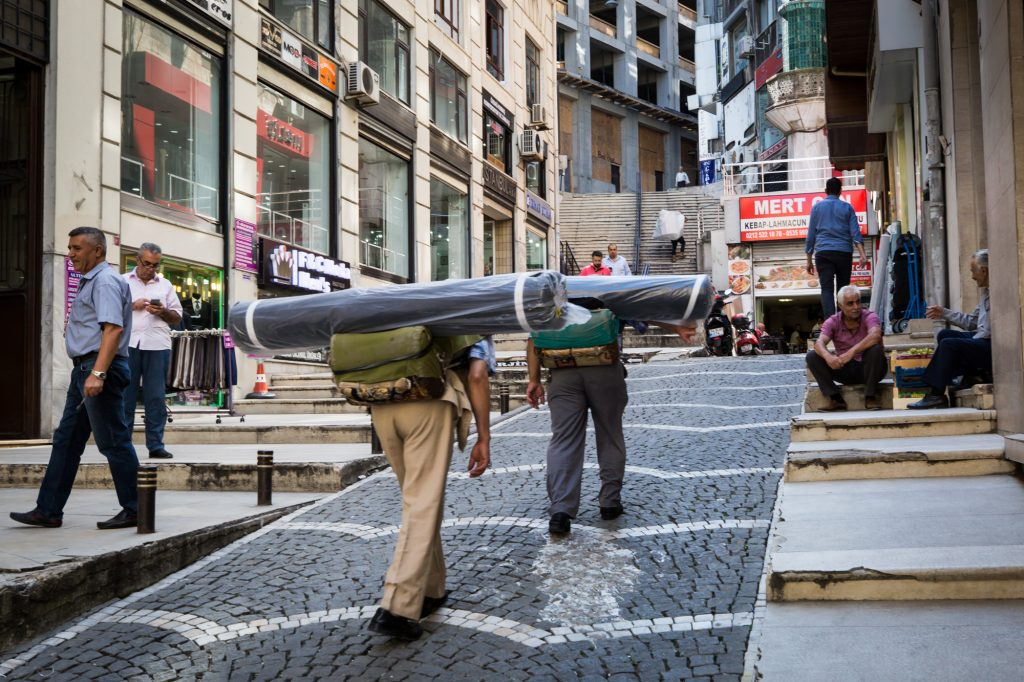 Men carrying fabric rolls for an article on Istanbul street photos
