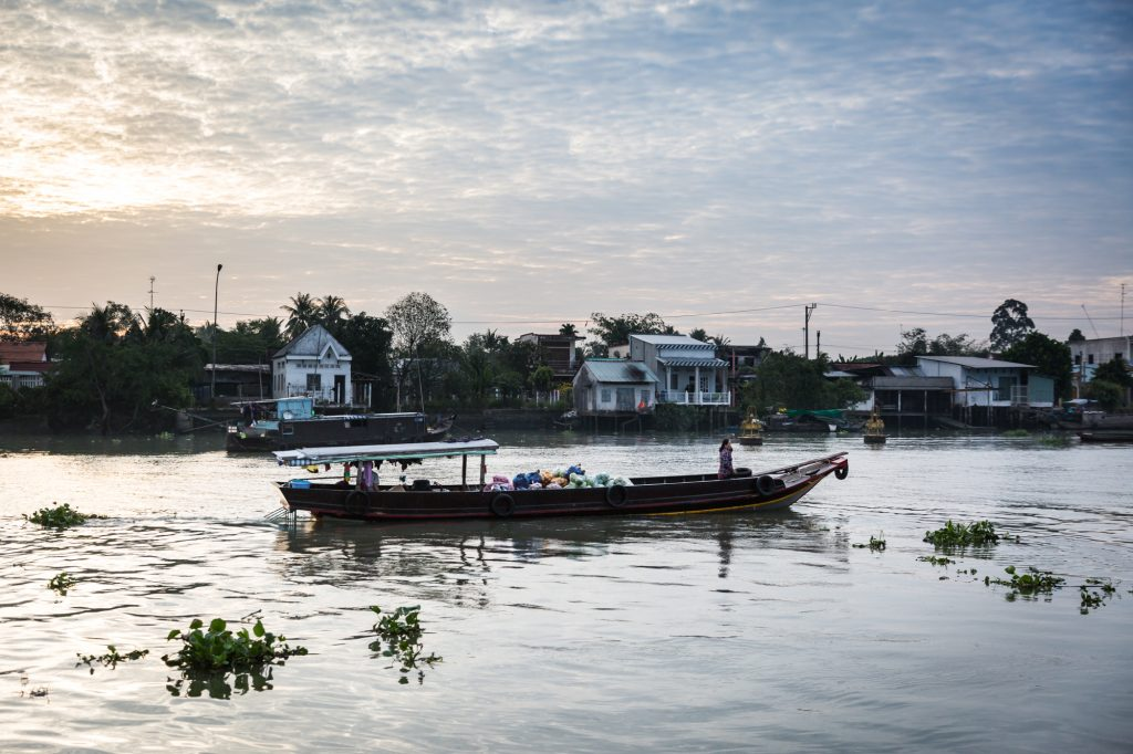 Boat in river for an article on the Cai Be Floating Markets
