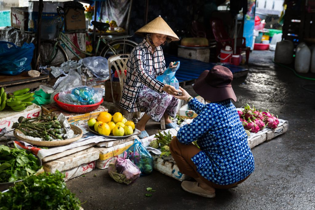 Busy market for an article on the Cai Be Floating Markets