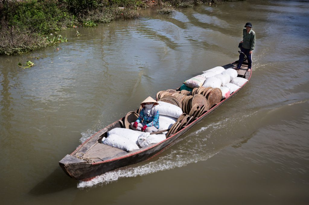 Boat in the river for an article on the Cai Be Floating Markets