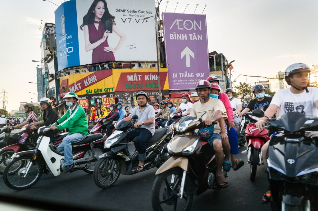People on motorcycles for article on Ho Chi Minh City street photos
