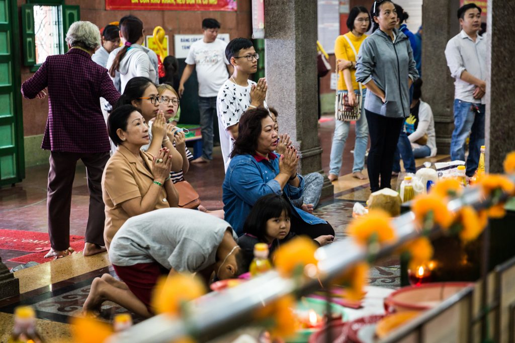 People praying in the Mariamman Hindu temple for article on Ho Chi Minh City street photos
