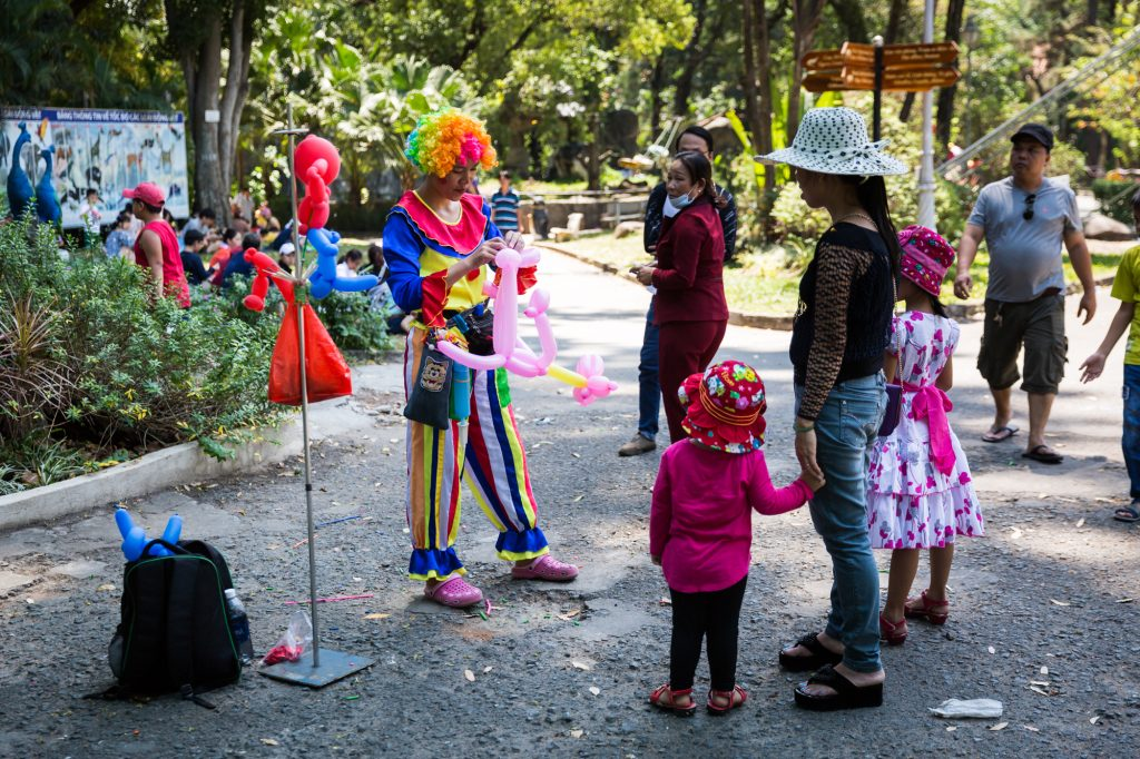Clown and families at the Saigon Zoo and Botanical Garden for article on Ho Chi Minh City street photos