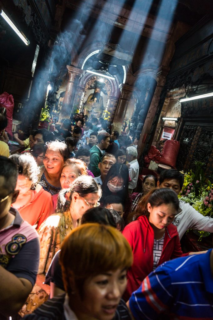 Worshippers at the Ba Thien Hau temple for article on Ho Chi Minh City street photos