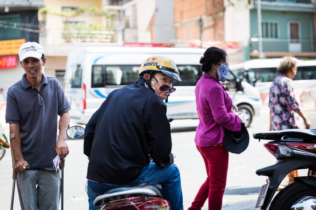 Man with sunglasses on motorcycle for article on Ho Chi Minh City street photos