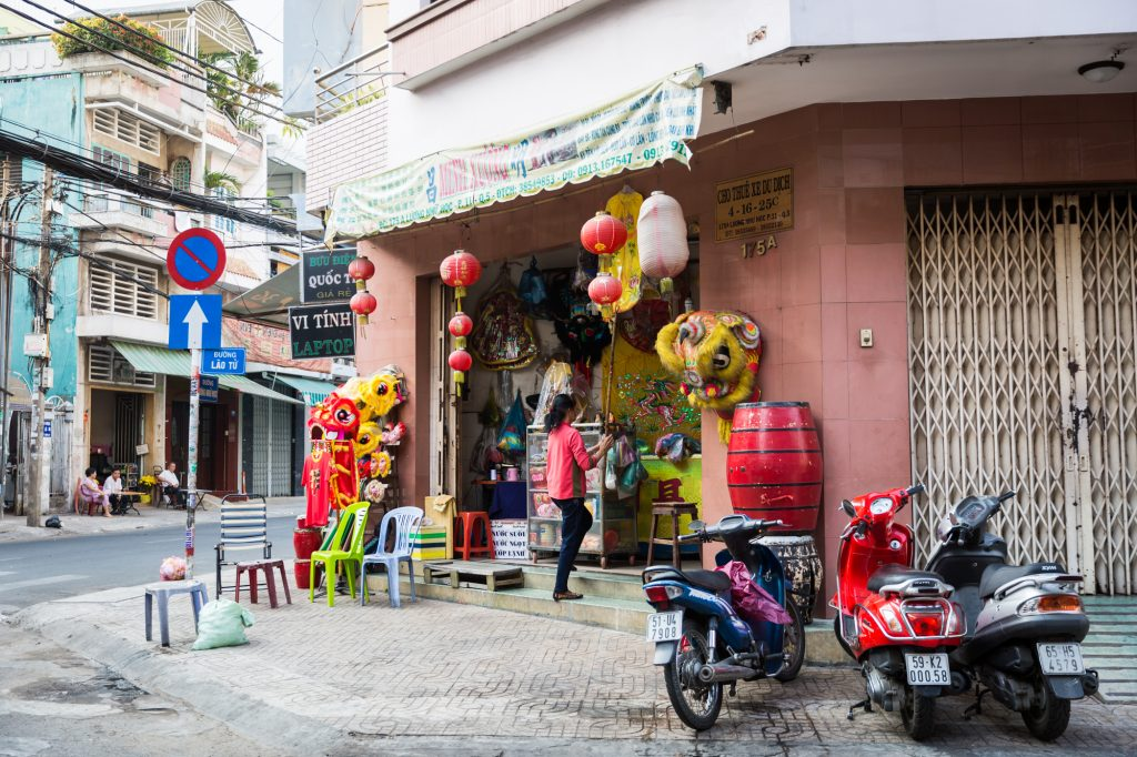 Chinese new year decorations for sale for article on Ho Chi Minh City street photos