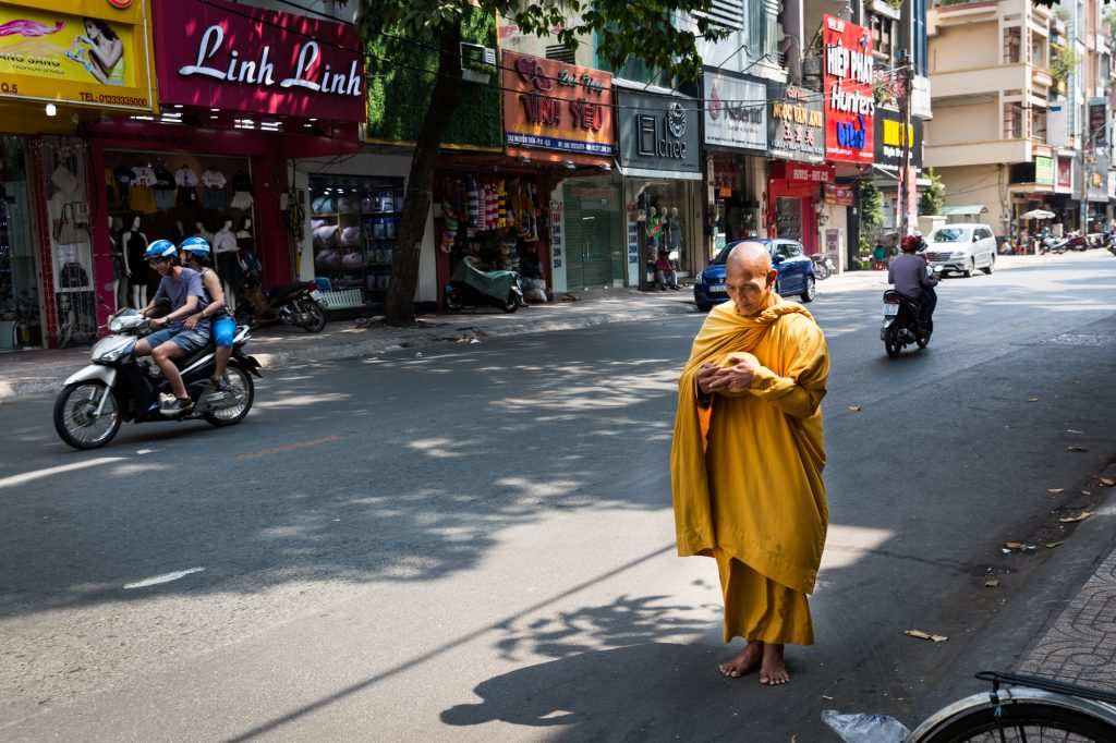 Monk begging for alms for article on Ho Chi Minh City street photos