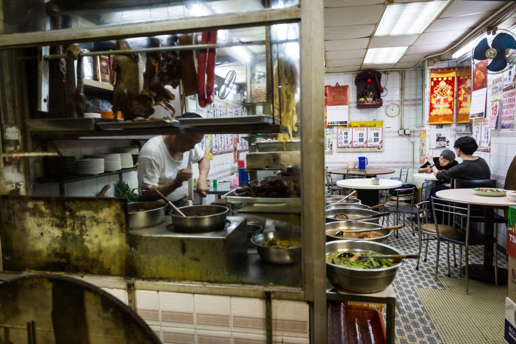 People eating in a Hong Kong restaurant for a Hong Kong travel guide article