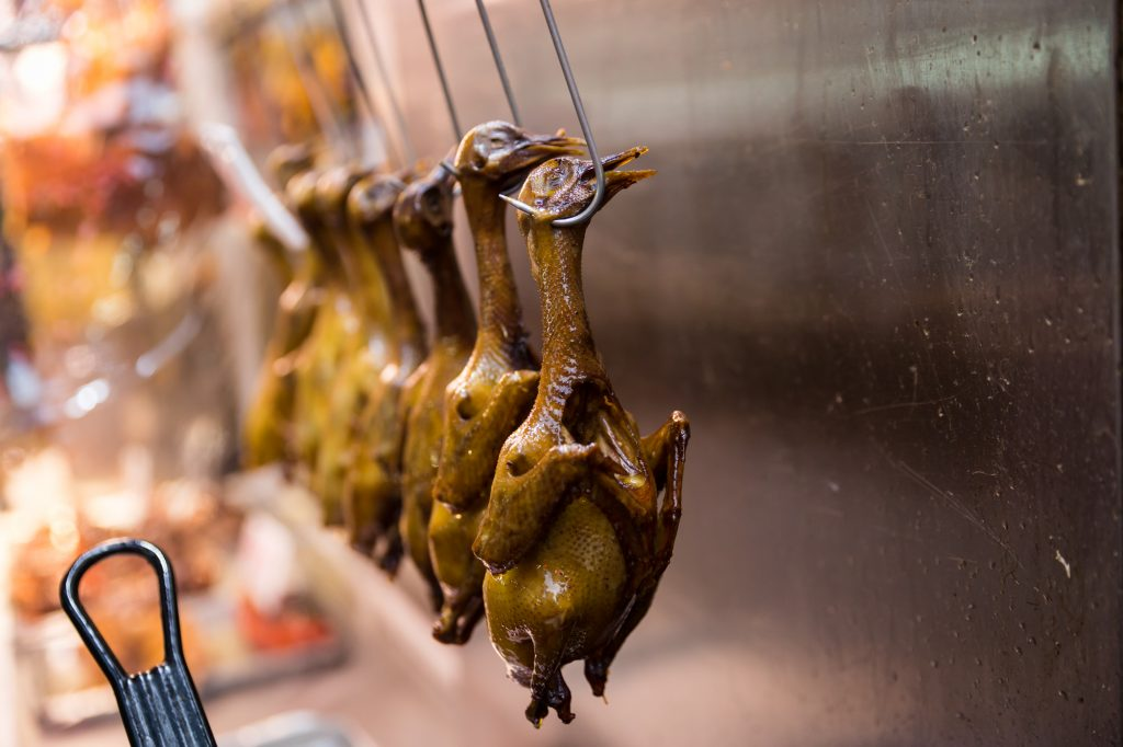 Peking ducks hanging for a Hong Kong travel guide article