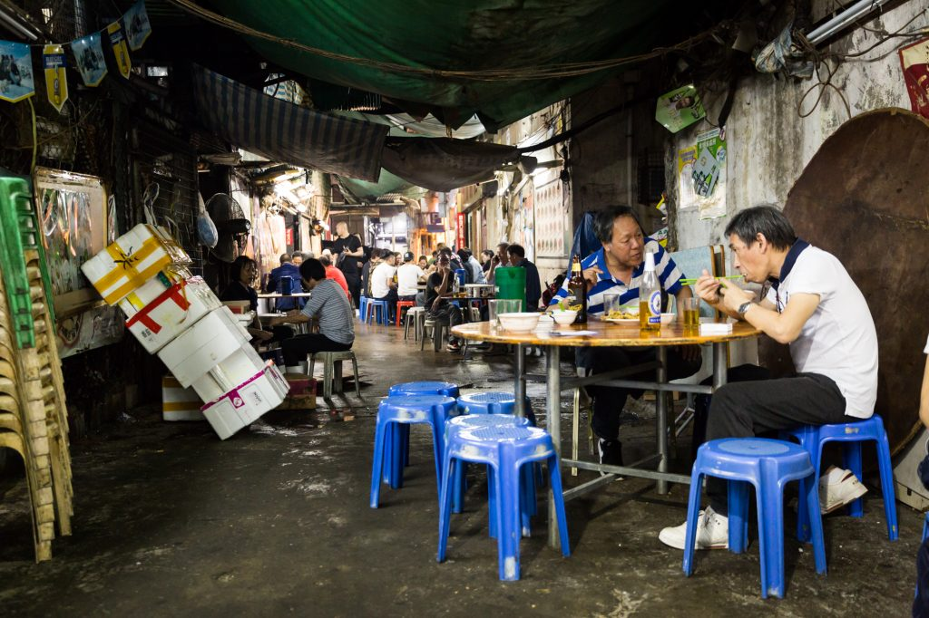People eating at Temple Street Night Market restaurant
