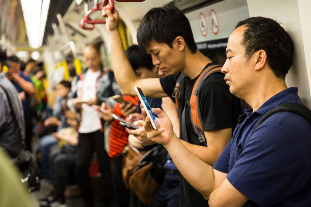 Communters on the MTR subway for a Hong Kong travel guide article