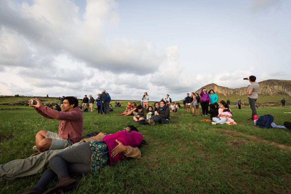 Tourists at Ahu Tongariki for an Easter Island travel guide