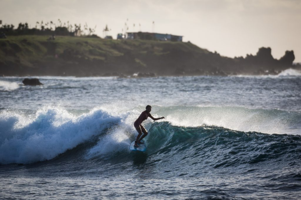 Surfer on a wave for an Easter Island travel guide